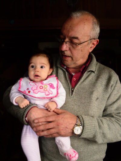 Older man holding a baby
